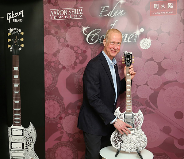 "Gibson Brands has announced the inaugural collaboration between world-class jewelry designer Aaron Shum, founder of CORONET® and celebrated musician and designer Mark Lui in the design of the truly exquisite ""Eden of CORONET®"", a Diamond Gibson Guitar masterpiece."