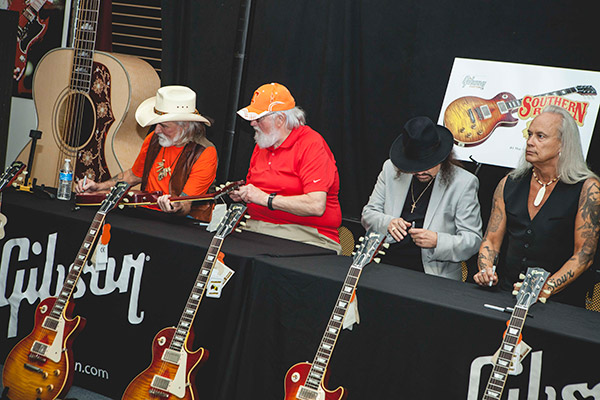 Dickey Betts, Charlie Daniels, Gary Rossington and Rickey Medlocke signing 50 guitars
