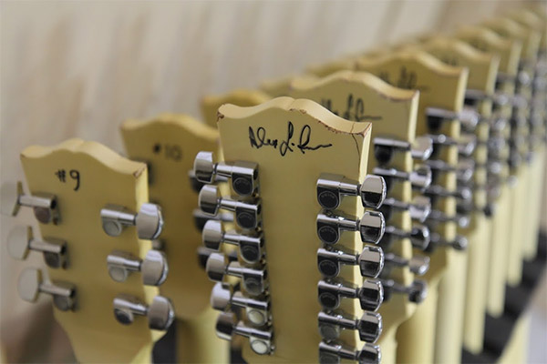 Alex Lifeson of RUSH signing guitars at the Gibson Custom Shop