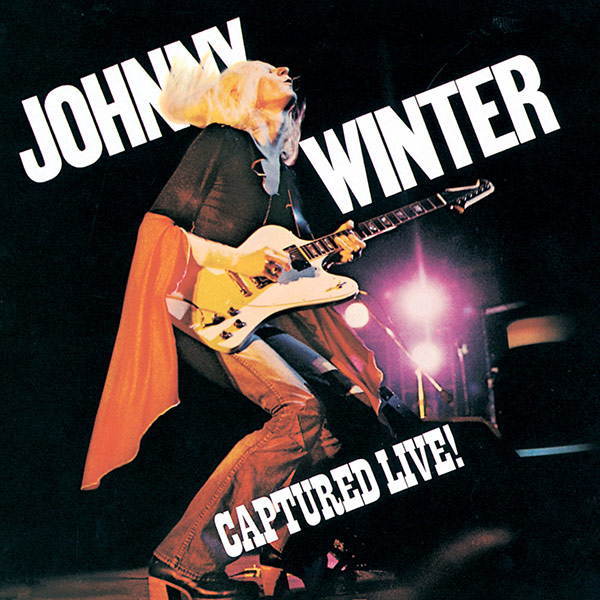 Johnny Winter holding a Gibson Firebird