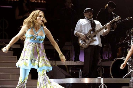 Jennifer Lopez with Bassist Erben Perez playing a Tobias bass