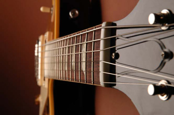 The Frets: If the frets are not level and properly crowned, the guitar can sound out of tune. In extreme cases, a fretted note will actually sound at an adjacent, higher fret.