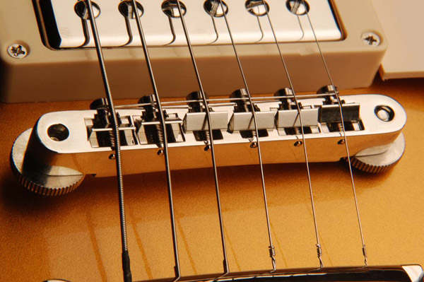 The Bridge: A bridge that needs to be adjusted too low or too high may be an indication of a neck that needs resetting. An improperly set neck can cause the entire guitar to play out of tune. The bridge or saddles should be intonated with a properly calibrated strobe or electronic tuner.