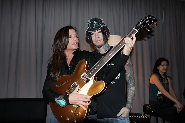DJ Ashba and Kelly LeBrock with Gibson Guitar