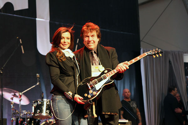 Pete Allman and Kelly LeBrock with Gibson Guitar