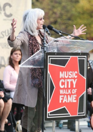 Emmylou Harris speaking at awards ceremony