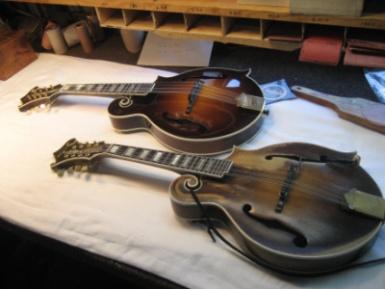 Gibson Sam Bush Signature mandolin next to the original Ole Hoss