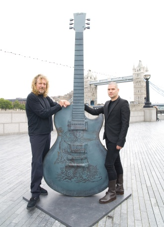 Robert Plant and his signed London Guitartown guitar