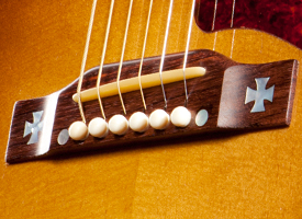how to fit a strap to an acoustic guitar